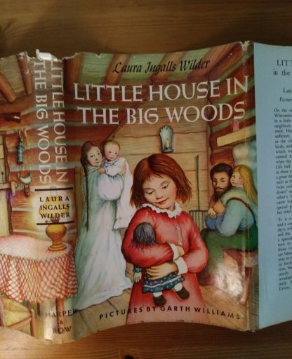 Close up of front of dust jacket of book, Little House in the Big Woods, 1953 Uniform edition
