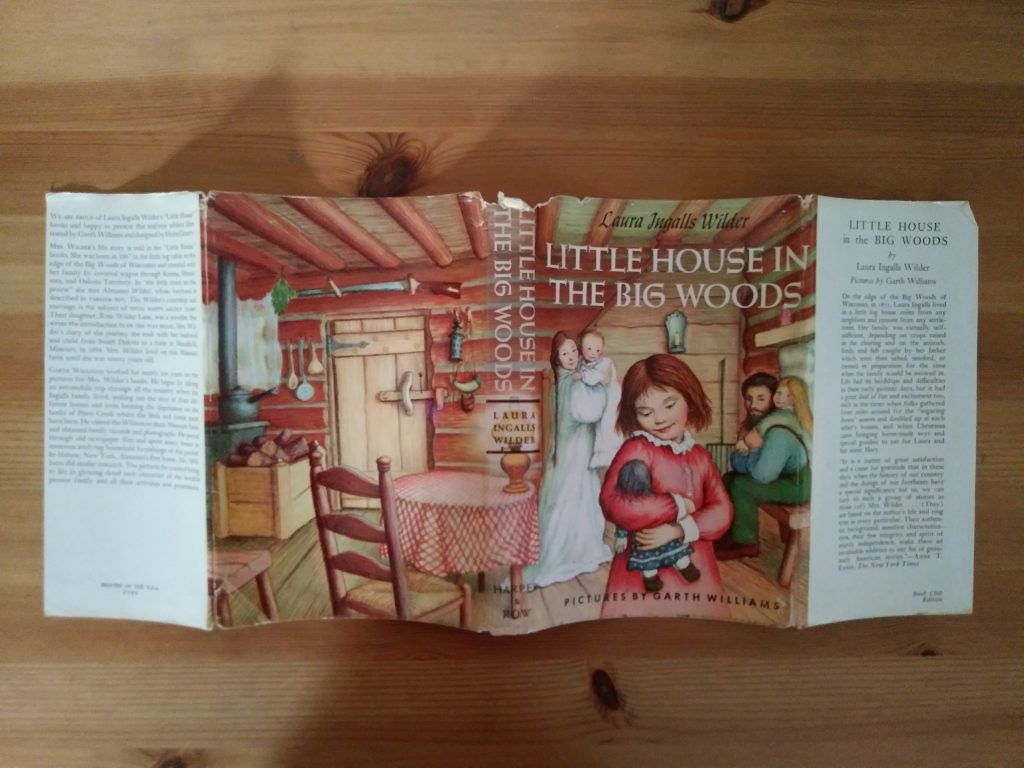 Dustjacket for the book, Little House in the Big Woods, 1953 Uniform edition