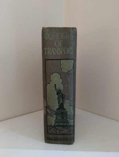 binding with the image of statue of Liberty, on an Antique Book Wonders of Transport, By Cryril Hall, Triumphs of Enterprise