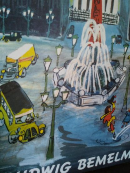 Close up of writing on front cover of a 1958 copy Madeline and the Bad Hat, First European Release
