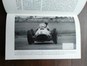 photograph of a racecar in a 1959 copy of The Racing Driver by Denis Jenkinson