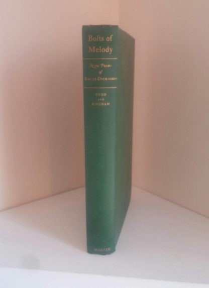 Spine view of a 1945 First Edition of Bolts of Melody by Emily Dickinson