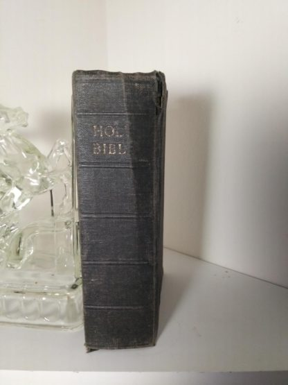 Spine view of a 200-year-old Bible, published in 1812 by the American Bible Society