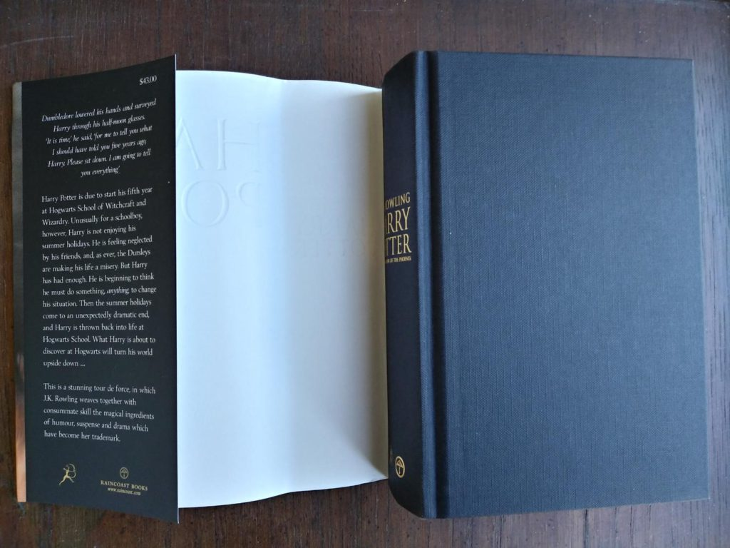 black cloth board on a 2003 copy of Harry Potter and the Order of the Phoenix, stated First Canadian Edition