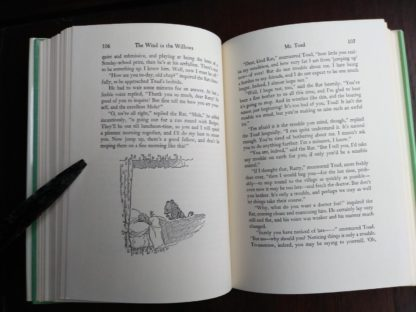 page 106 and 107 in a 1960 Golden Anniversary Edition of The Wind in the Willows by Kenneth Grahame
