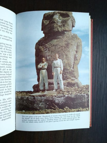 photograph of a giant statue in a 1958 First Edition of Aku-Aku, The Secret Of Easter Island