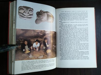 photographs of a magic guardian head and of an underground family cave in a 1958 First Edition of Aku-Aku, The Secret Of Easter Island