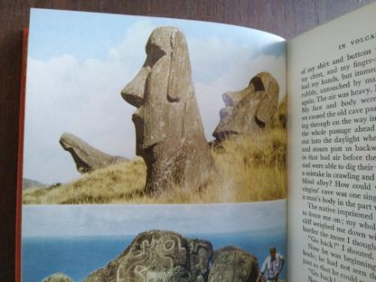 photographs of the Easter island statues in a 1958 First Edition of Aku-Aku, The Secret Of Easter Island