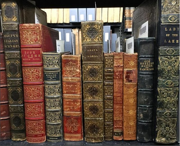 shelf of old books at Queens rare book library