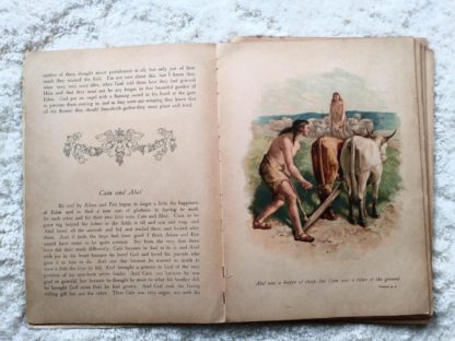image of Cain and Able in Picture Stories from the Bible published by Raphael Tuck & Sons with chromolithograph illustrations by John Lawson