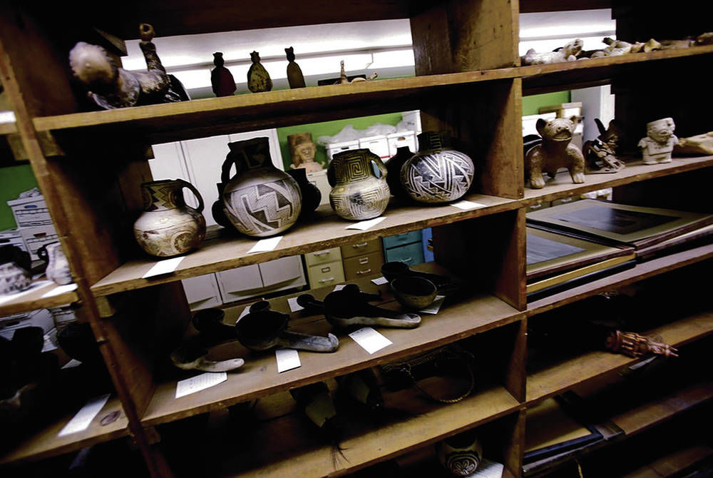 Shelves of artifacts at the Fogelson Library on the former campus of the Santa Fe University of Art and Design