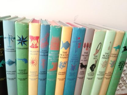 popular titles from childrens Junior Deluxe Editions Collection, Circa 40s -50s, spines up close