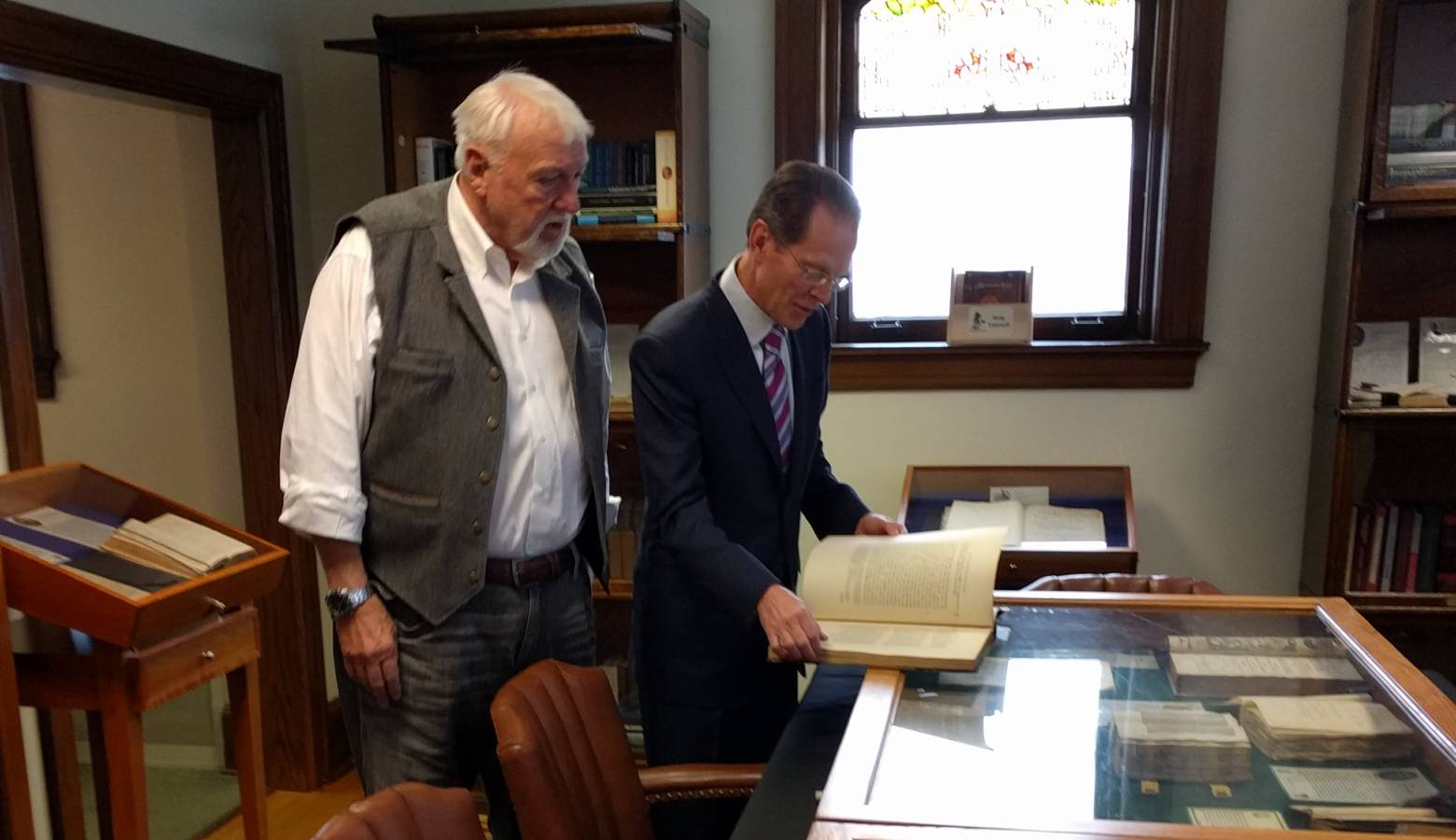 Ball State University President Geoffrey Mearns looks through Blackstones Magna Carta with Remnant Trust founder Brian Bex.