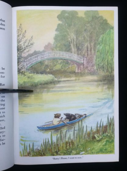 The Wind in the Willows 1961 Golden Anniversary Edition colour illustration of Rat and Mole in the row boat on the river by Ernest Shepard