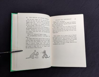 page 34 and 35 in a 1963 copy of The House at Pooh Corner by A. A. Milne
