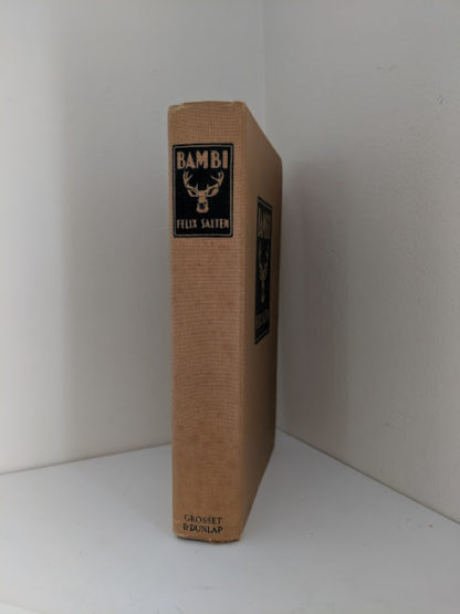 spine view of a 1929 copy of Bambi by Felix Salten published by Grosset & Dunlap