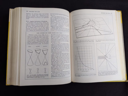 Exploring the Atom pages inside a 1960 copy of Physics - Physical Science Study Committee - First Edition