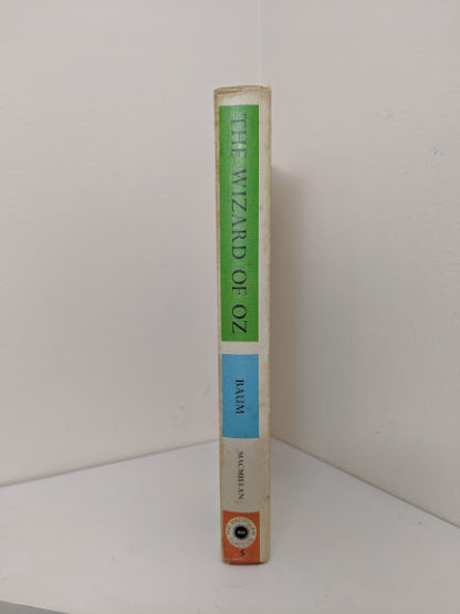 spine view of a 1962 copy of The Wizard of Oz published by Macmillan Company with illustrations by Denslow