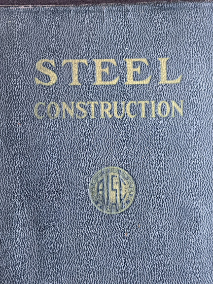 1941 copy of Steel Construction published by American Institute Of Steel Construction- third edition - fourth printing - front cover up close
