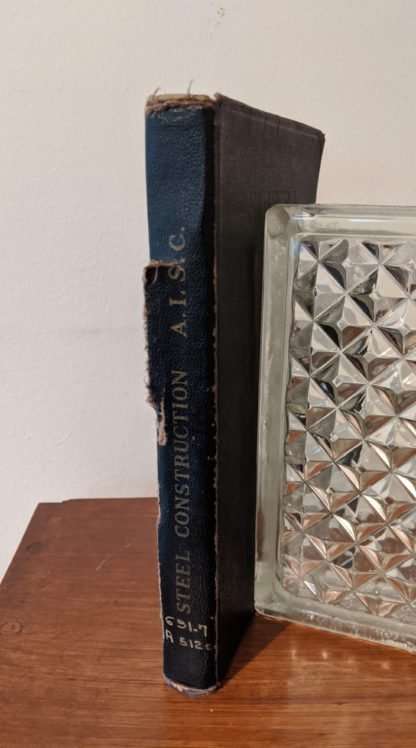 1941 copy of Steel Construction published by American Institute Of Steel Construction- third edition - fourth printing - spine view