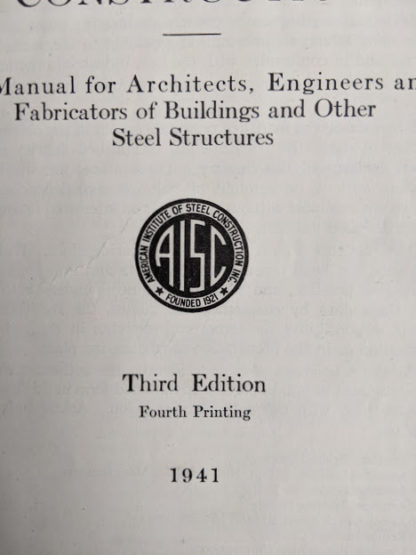 1941 copy of Steel Construction published by American Institute Of Steel Construction- third edition - fourth printing - title page up close