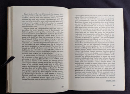 Page 122 and 123 inside a 1958 first edition copy of KLONDIKE - The Life and Death of the Last Great Gold Rush by Pierre Berton