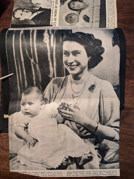Princess Elizabeth holds in her arms baby prince Charles