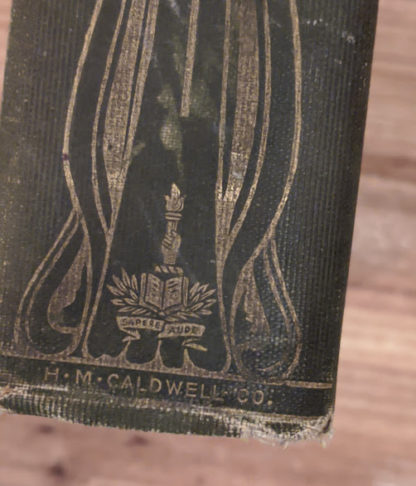 bottom of the spine - Sapere Aude - 1900 copy of The Three Musketeers by Alexandre Dumas - Published by Caldwell Company Publishers