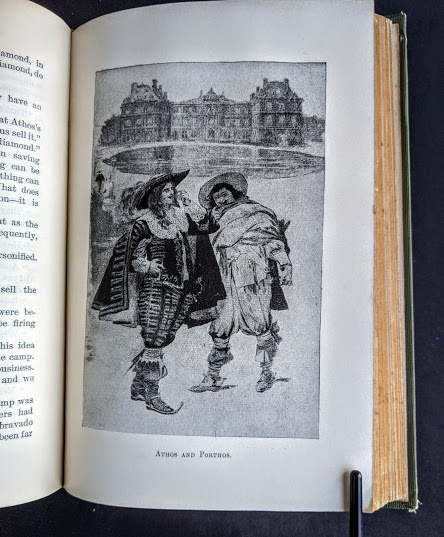 illustration of Athos and Porthos inside a 1900 copy of The Three Musketeers by Alexandre Dumas - Published by Caldwell Company Publishers