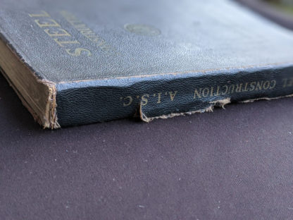 tear in spine on a 1941 copy of Steel Construction published by American Institute Of Steel Construction- third edition - fourth printing