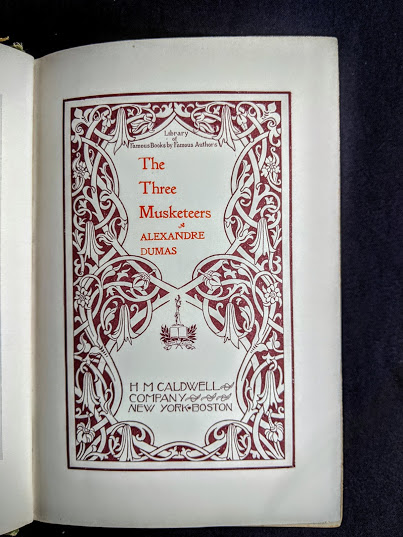title page up close inside a 1900 copy of The Three Musketeers by Alexandre Dumas - Published by Caldwell Company Publishers