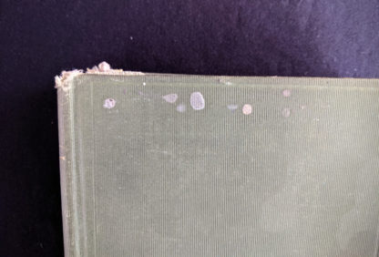top edge of front cover on a 1900 copy of The Three Musketeers by Alexandre Dumas - Published by Caldwell Company Publishers
