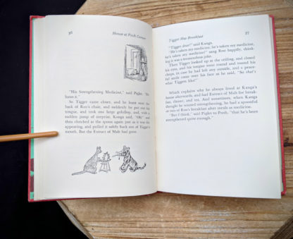 page 36 and 37 inside a 1961 copy of The House at Pooh Corner by A.A. Milne