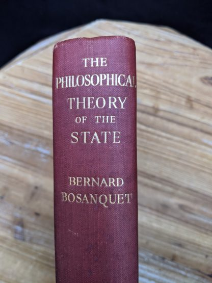 Upper Spine view - 1930 copy of The Philosophical Theory of the State by Bernard Bosanquet - signed by H. S. Harris