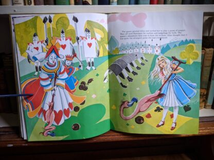 illustration of Alice playing croquet with the Queen -1985 Alice in Wonderland - Ottenheimer Publishers - Printed in Italy