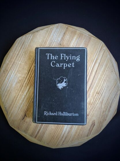 Front panel on a 1932 copy of The Flying Carpet by Richard Halliburton - First Edition
