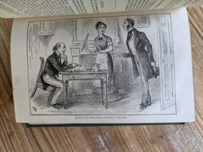 Making the Beef Steak Pudding -antiquarian copy of The Life and Adventures of Martin Chuzzlewit by Charles Dickens - Circa 1880's - undated