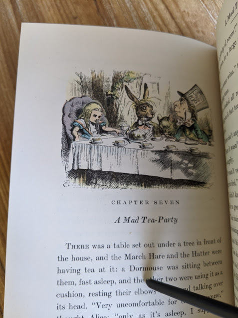 A Mad Tea Party - Colour illustration by John Tenniel inside a 1946 Alice's Adventures in Wonderland - Two Volumes - by Lewis Carroll. Published by Random House, New York - Special Edition