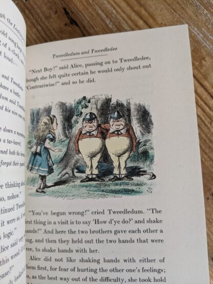 illustration of Tweedledum and Tweedledee by John Tenniel inside a 1946 Through The Looking-Glass - Two Volumes - by Lewis Carroll. Published by Random House, New York - Special Edition